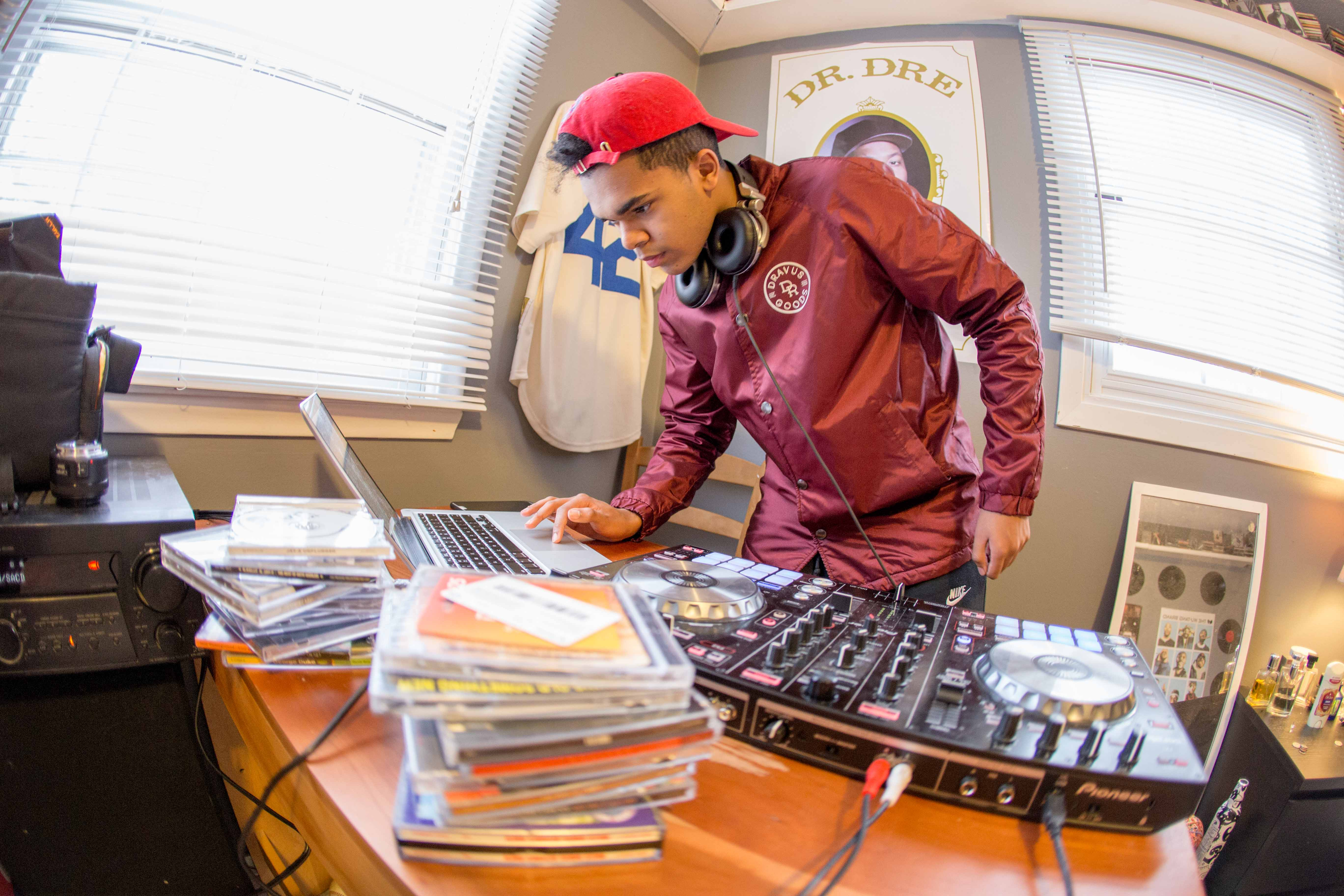 Sophomore Joe Holloway mixes a Kendrick Lamar song in his bedroom Feb. 7. Holloway has been DJing for approximately a year-and-a-half and focuses on heavy bass and trap music.