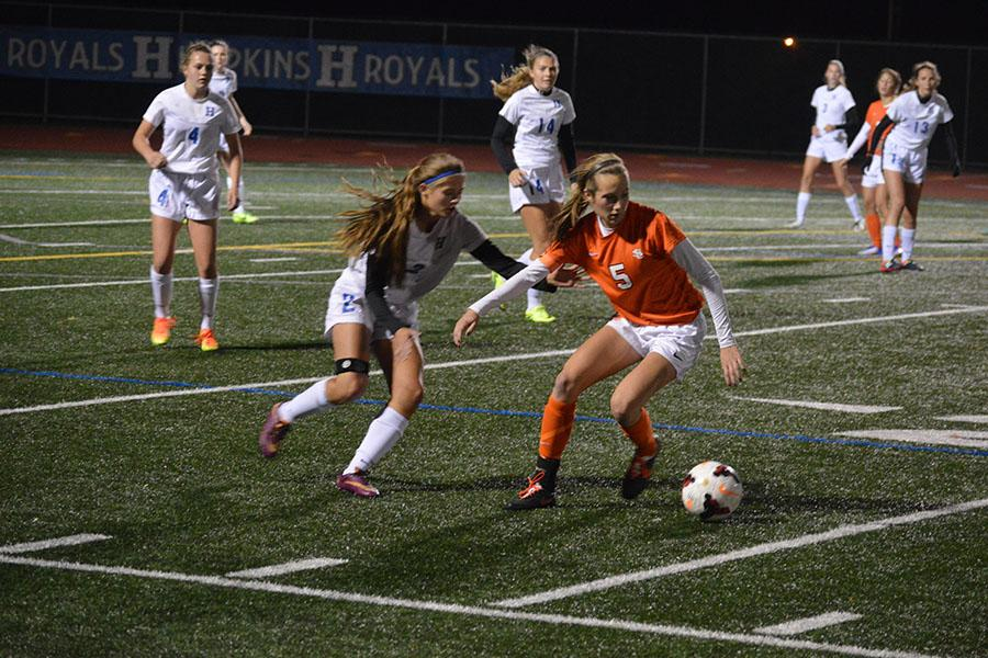 Senior Captain Sammi Baer protects the ball from the opponent. The Orioles lost 1-3 in the Oct. 13 game.