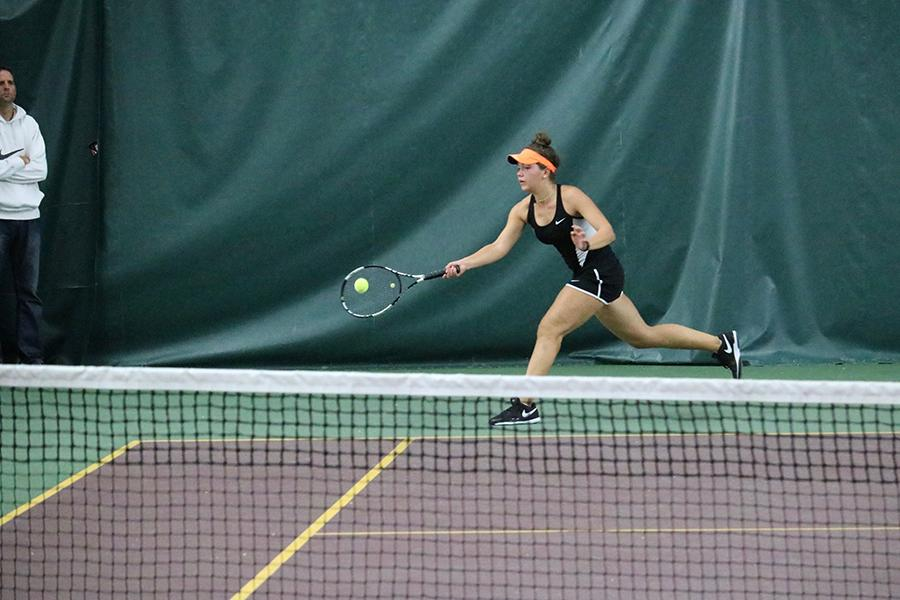 Senior Natalie Lorentz competes at the tennis State tournament Oct. 27. She won her first match, but lost in the quarterfinal, ending her high school career.