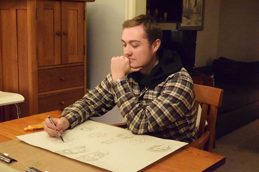 Senior Calvin Youngren sketches faces of random caricature-like people at his house to practice skills and prepare for his five hour class every Tuesday at the Minneapolis College of Art and Design Dec. 6.