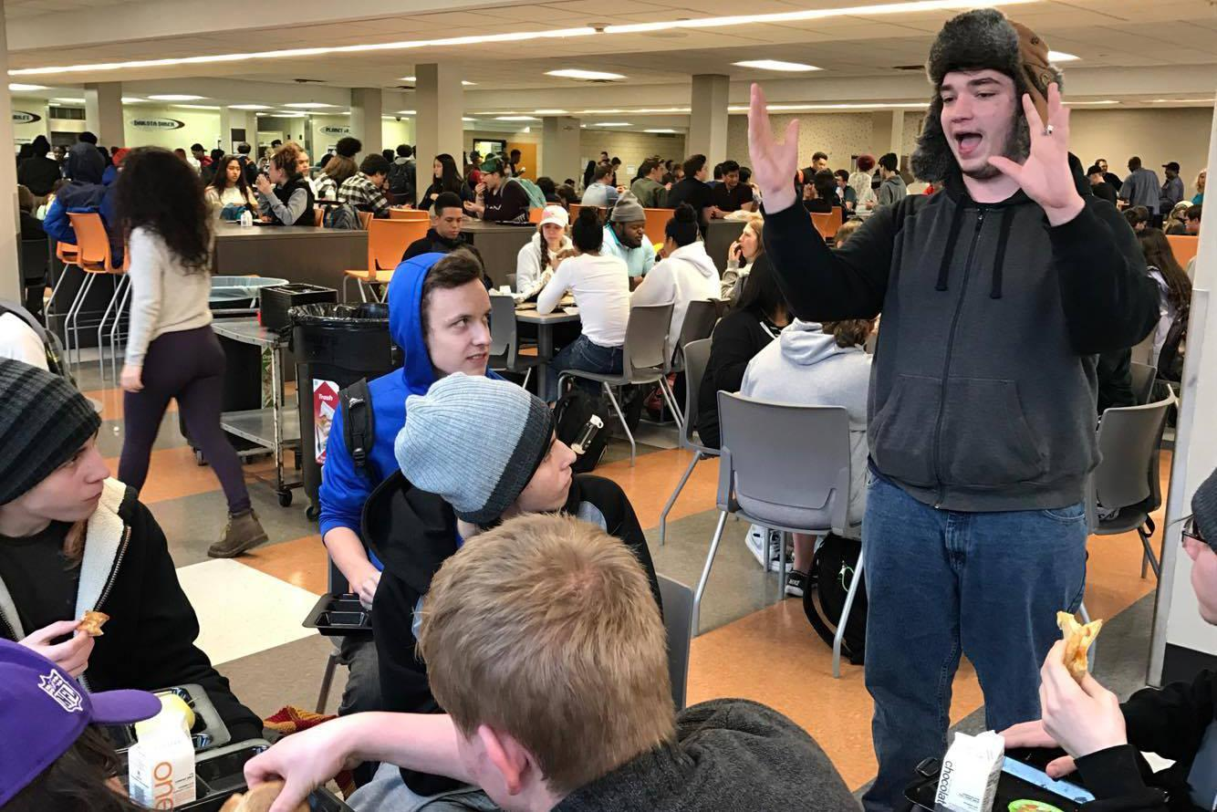 Senior Kaleb Schweizer performs a comedy set for his friends in the lunchroom Feb. 24. Schweizer performs stand up comedy at open mic events around the cities.
