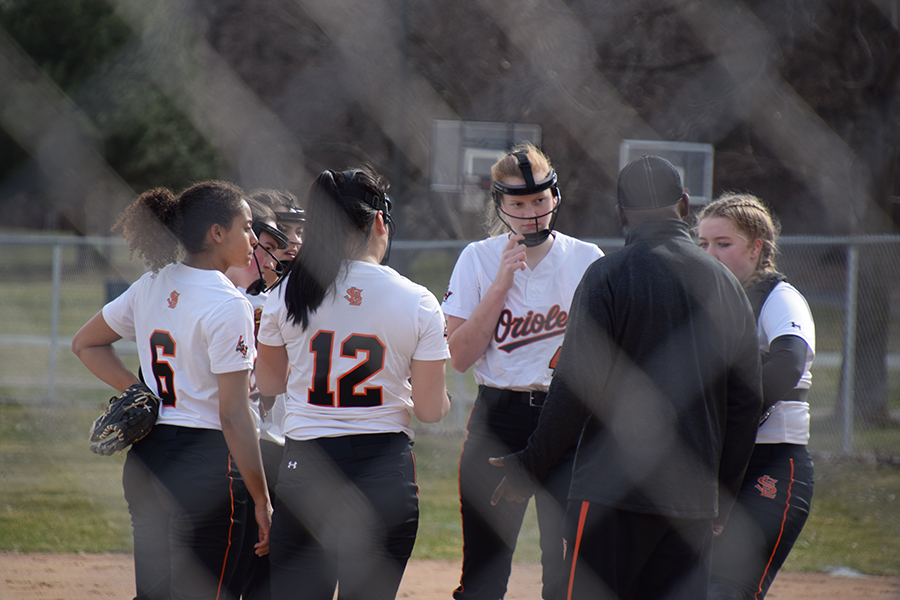 Park+softball+players+meet+in+the+infield.++Park+senior+Anya+Lindell+Paulson+hit+a+grand+slam+in+the+sixth+inning+to+give+Park+a+6-3+win+over+Chaska.