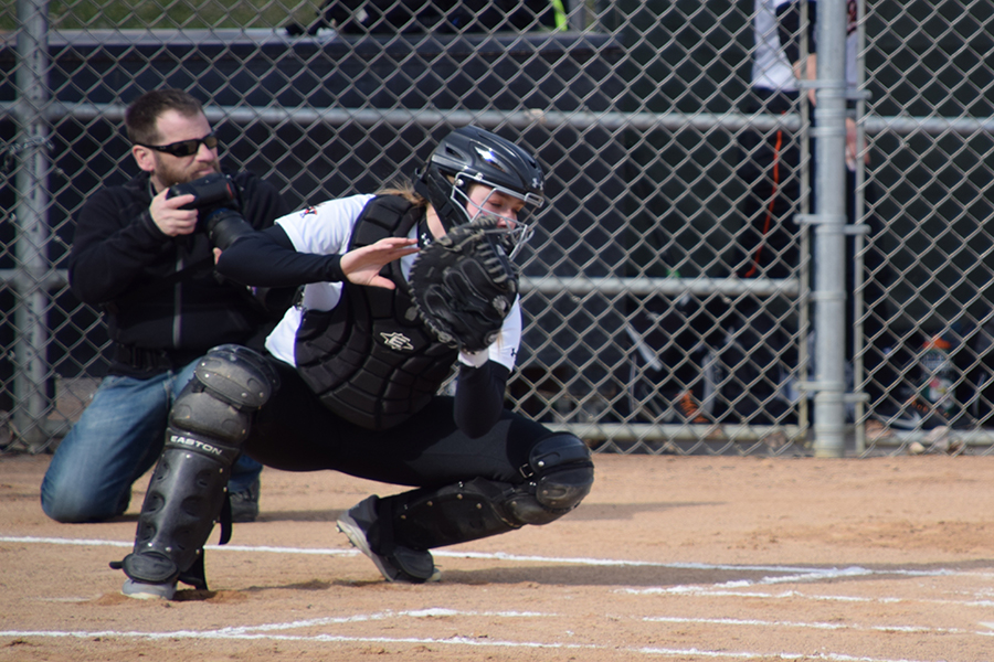 Sophomore+catcher+Maddy+Schmitz+catches+the+softball+during+team+warmups+before+a+game.+Sections+are+set+to+start+May+22.+++