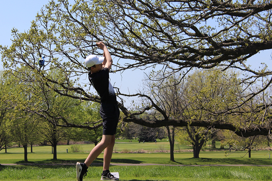 Freshman+Charlie+Harper+holds+his+follow+through+after+teeing+off+on+the+first+hole.+The+team+placed+fourth+in+the+conference+match.