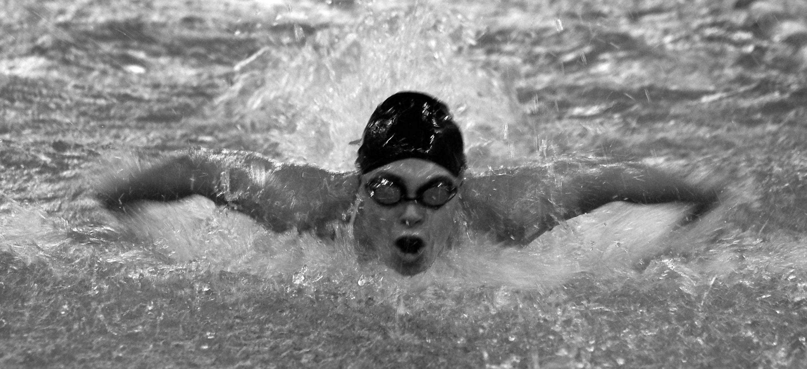 Brisk Butterfly: Senior captain Kathryn Ostrom competes in the 100 butterfly in a meet against Totino-Grace Oct. 4.