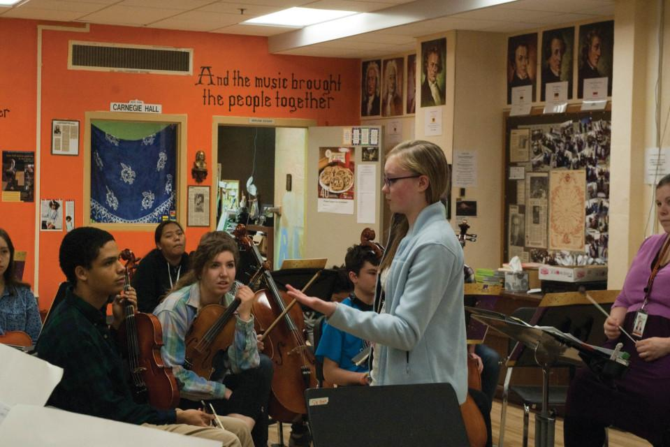 Directing the music: Eighth grader Kinsey Scott talks to members of the orchestra about her original composition a tribute to the victims of Sandy Hook shooting, during a Nov. 19 rehearsal.