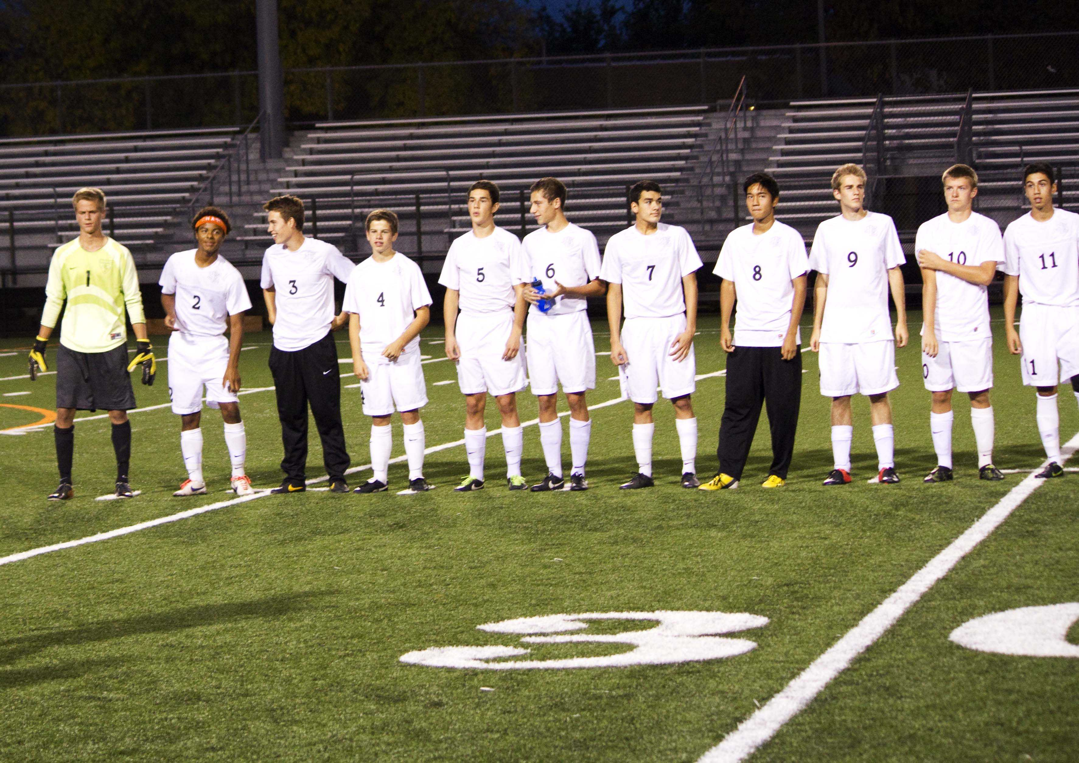 Senior Evan McManus (9) joins his teammates in the starting lineup during a varsity soccer game last  fall.