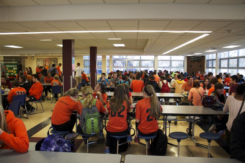 Students+dressed+in+orange+supporting+the+McManus+family+fill+the+cafeteria+April+10.