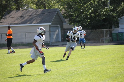 Football team touches down in new conference