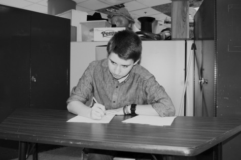 In the zone: Sophomore Dotan Appelbaum focuses intently on writing his rebuttal during debate practice. Debate team practices take place every Monday, Tuesday and Thursday in Mr. Redmond's room.