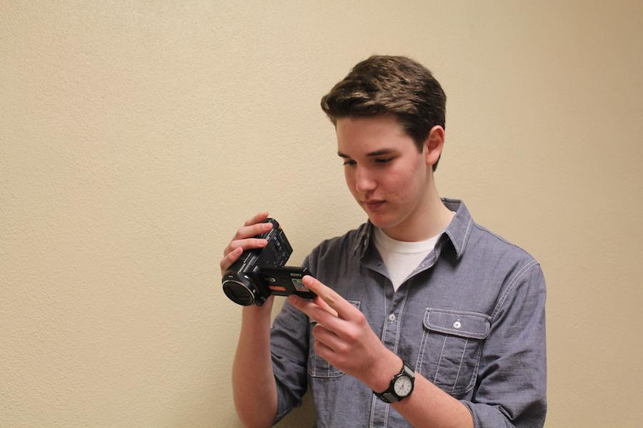Camera ready: Junior Charlie Berg looks over his most recent film, a hobby he has pursued in his free time. He spends part of his weekends editing his films and being a part-time filmmaker.
