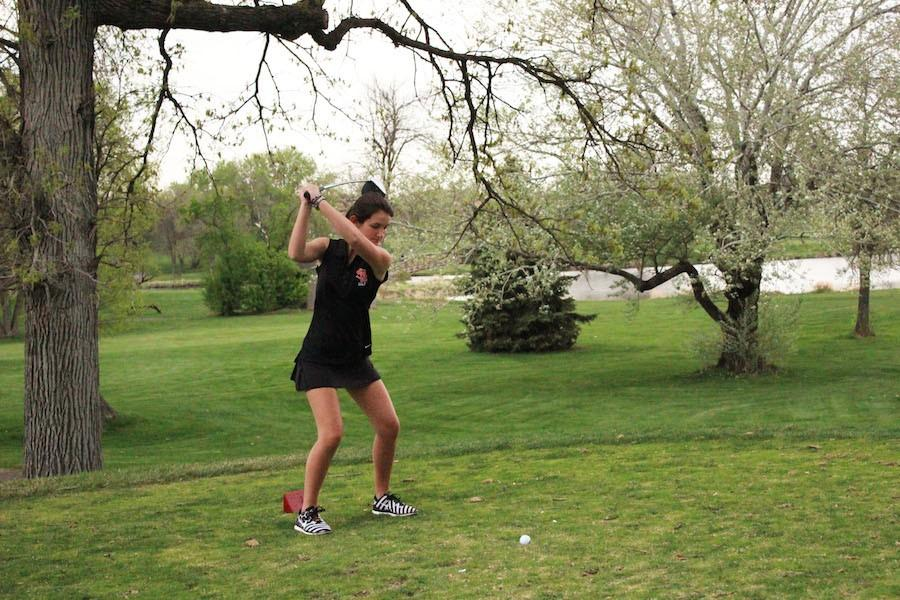 Freshman Izzy Leviton swings the putter during her JV match May 6 at Brookview Golf Course.