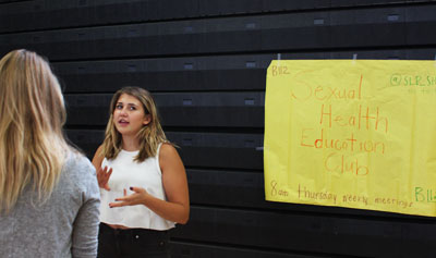 Senior Olivia Sieff, member of SHEC, explains what the club is about to incoming freshman at the activity fair Sept. 2.