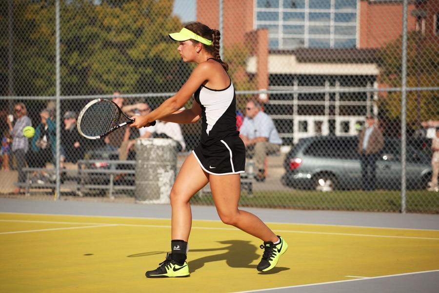 Junior+Natalie+Lorentz+returns+the+ball+during+a+match+against+Minneapolis+Washburn+Oct.+7.+The+team+won+4-3.