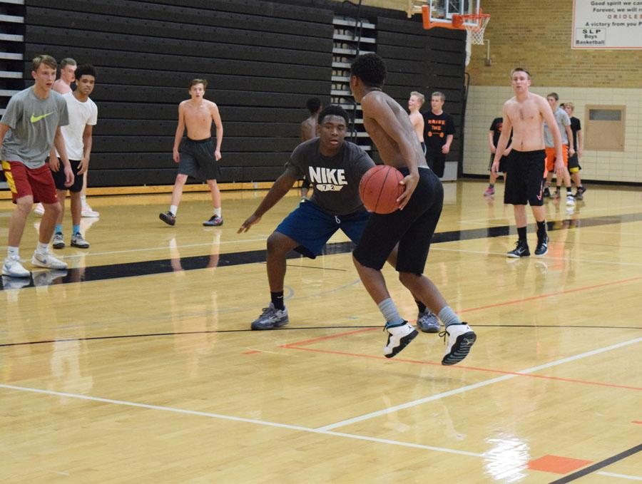 Sophomore+Cire+Mayfield+dribbles+towards+junior+Josiah+Morrow+during+open+gym+on+Nov.+2.