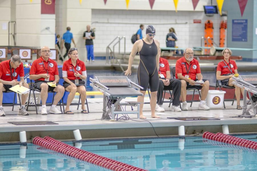 Senior+Heather+Westwood+prepares+to+mount+the+starting+block+at+the+girls%27+swimming+state+championship+Nov.+20+at+the+University+of+Minnesota+Aquatic+Center.