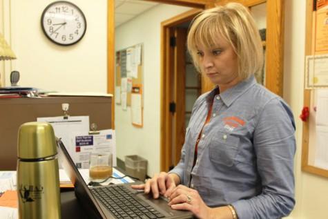 Kara Mueller, the college and career readiness adviser, responds to emails Nov. 6.