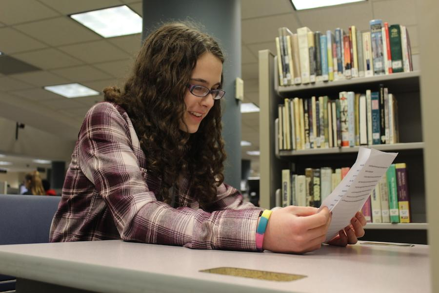 Junior Chava Buchbinder sits in the library media center working on an event for 36 Arts. Buchbinder plans to pass on her leadership role because she will not attend Park next year.
