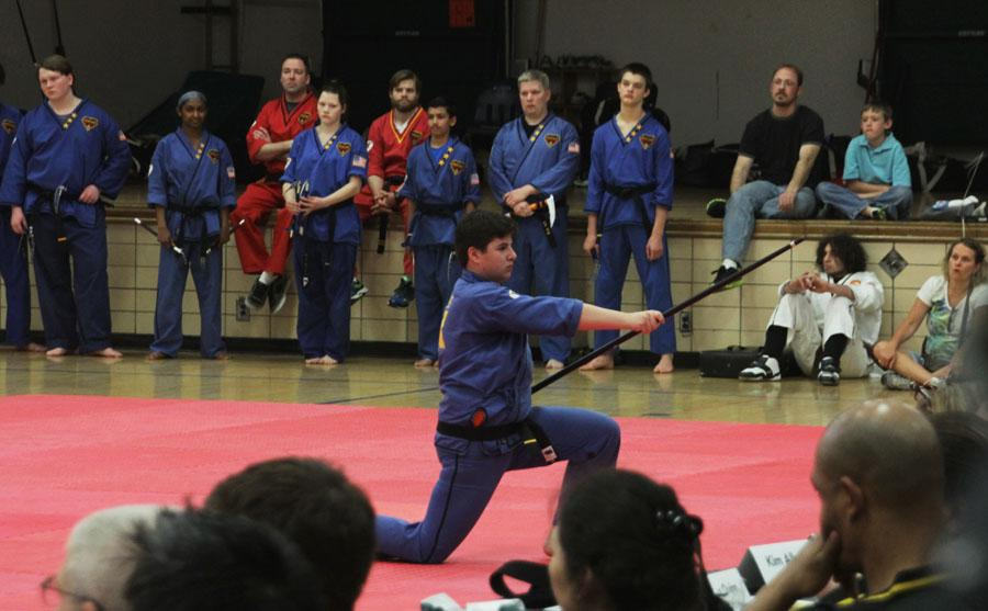 Sophomore Sam Birnberg performs his final move on his bo staff form for his black belt exam last April. Birnberg received his first black belt three years ago, his second one last April and hopes to continue adding onto his belt.