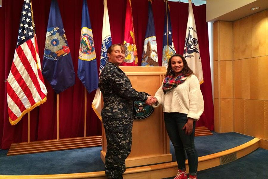 After signing with the National Guard, junior Aprille Lopac shakes hands with a representative Feb. 13. Lopac said she decided to join the National Guard because she wants to have a purpose as she decides on a career path.