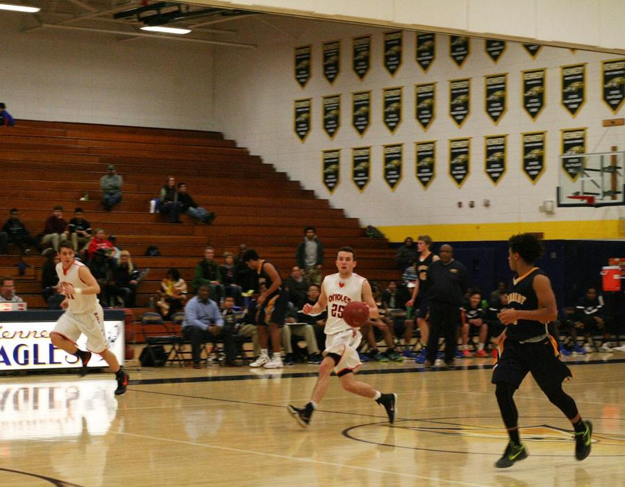Senior Ray Whitlock runs down the court at the game Feb. 5 against Bloomington Kennedy. The Oriole's won 74-66.