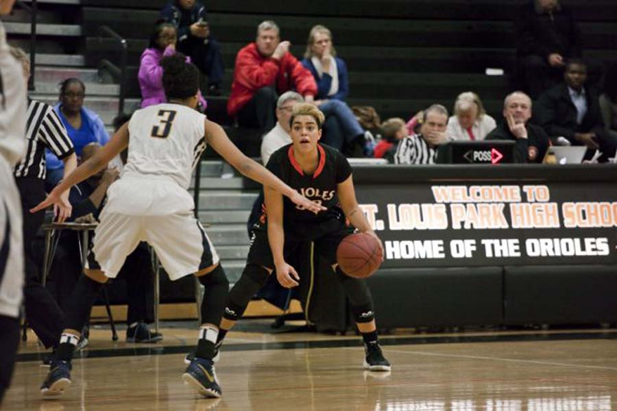 Senior Mara Henderson dribbles the ball at the game Feb. 5 against Bloomington Kennedy where Park won 74-66. Henderson recently reached the 1,000 point mark. The Orioles' next game is 7 p.m. Feb. 12 against Robbinsdale Cooper.