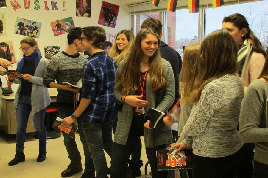 German+students+meet+in+German+teacher+Shari+Fox%27s+room+Feb.+8.+The+students+received+handbooks+and+ID+badges+from+the+school.+