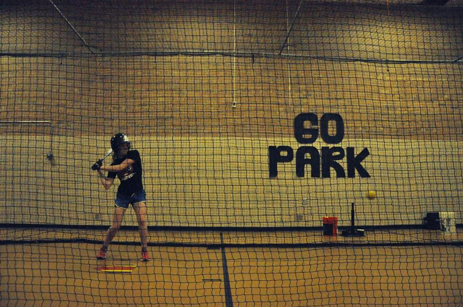Sophomore Megan Perkins practices on the pitching machine during a captains practice.