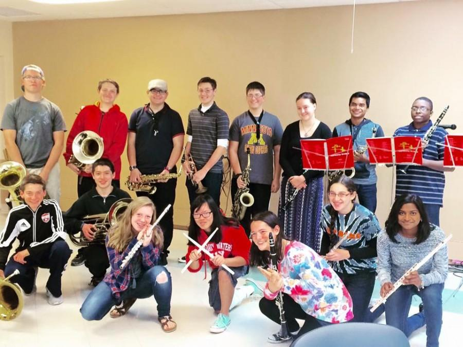 Sophomore Ethan Rickert, third from left, poses with other members of Park's band program after a Sunday performance at a senior home Oct. 25, 2015.