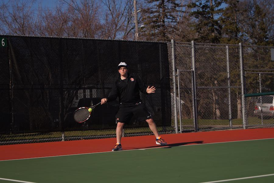Junior Jared Zirkes prepares to take a shot April 13 at his tennis scrimmage against Providence Academy. The varsity team has their first match 4 p.m. April 20 at the St. Louis Park High School tennis courts.
