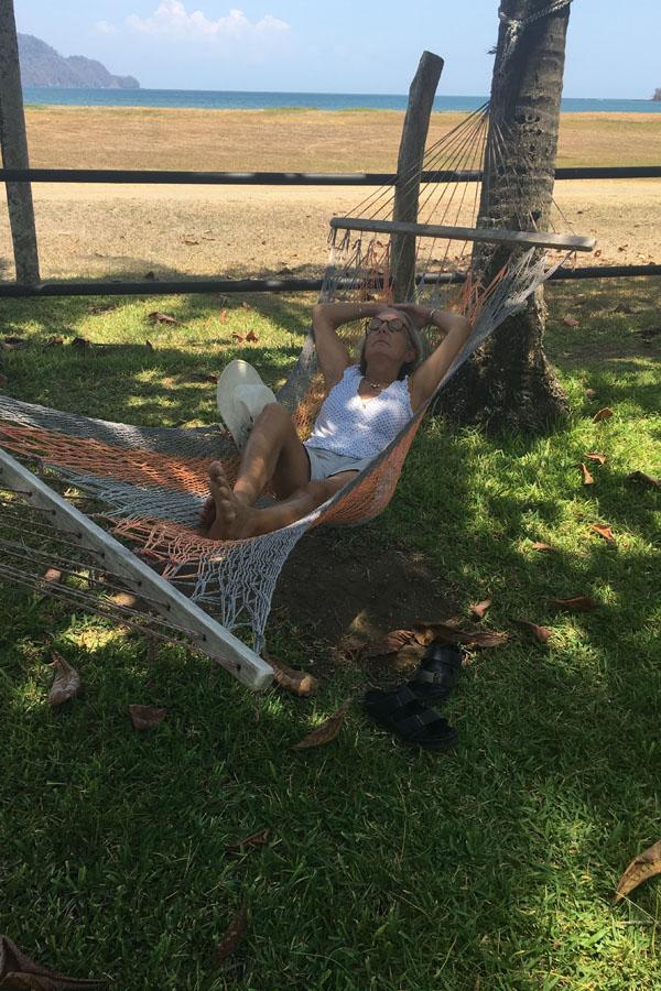 Mary Norris relaxes by the beach in a hammock on her trip to Costa Rica this year.