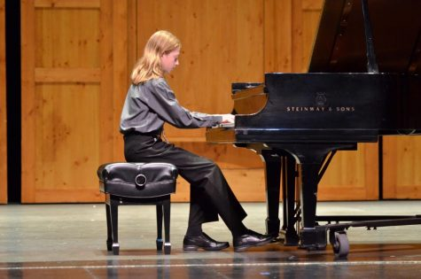 Freshman Marco Giovannelli plays at the Colorado Suzuki Institute during the summer as part of the recital program.