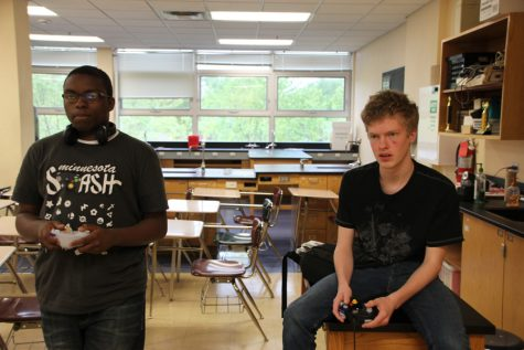 Sophomore Jeffery Robinson and freshman Christopher Anondson play games in Peter Dangerfield's room May 12.