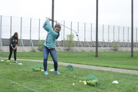 Girls' golf swings into motion