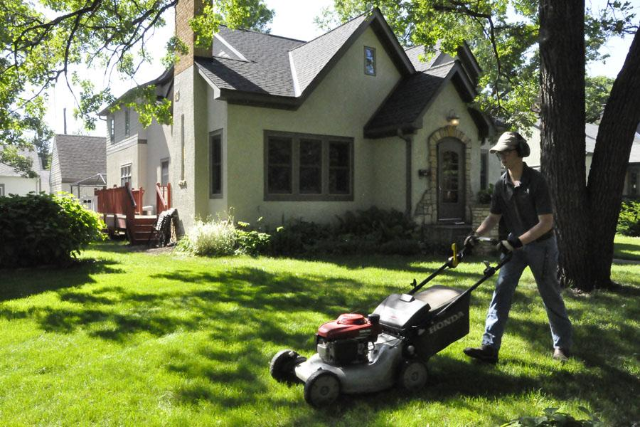 Sophomore Brendan Lindstrom mows a lawn June 2. With a good mix of both sun and rain, Lindstrom said he has a sufficient amount of lawns to mow.