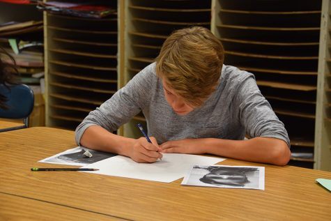 Sophomore Isaak Kimmel works with photo references to create a cubist self-portrait.