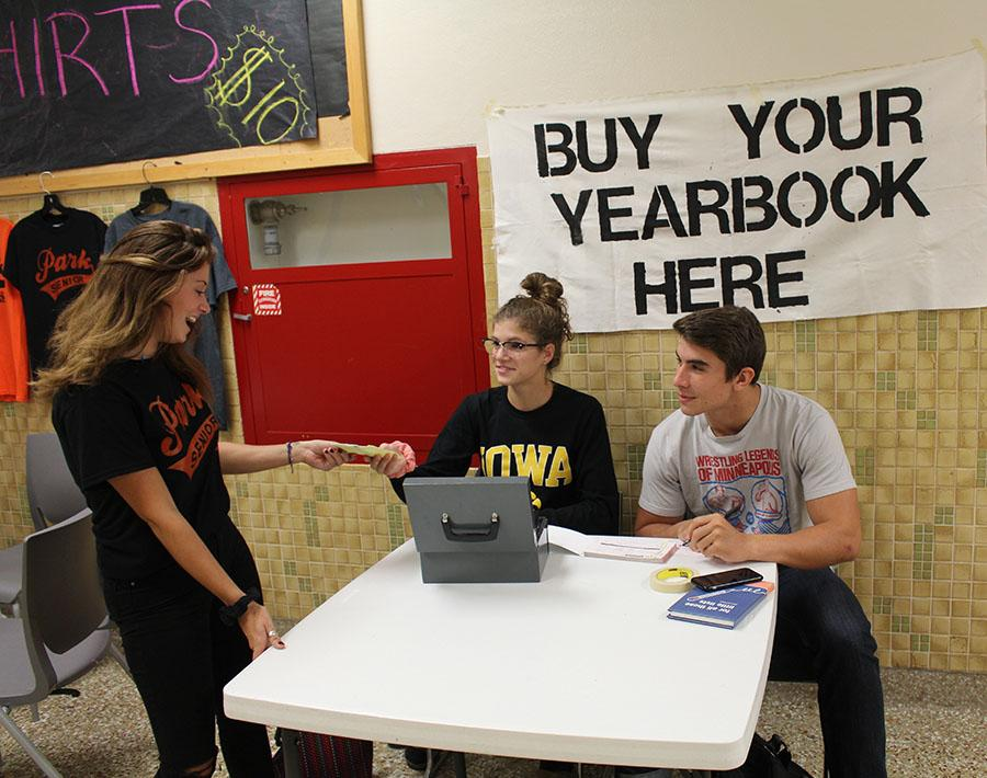 Senior Grace Feldman buys a yearbook during lunch Sept. 26.