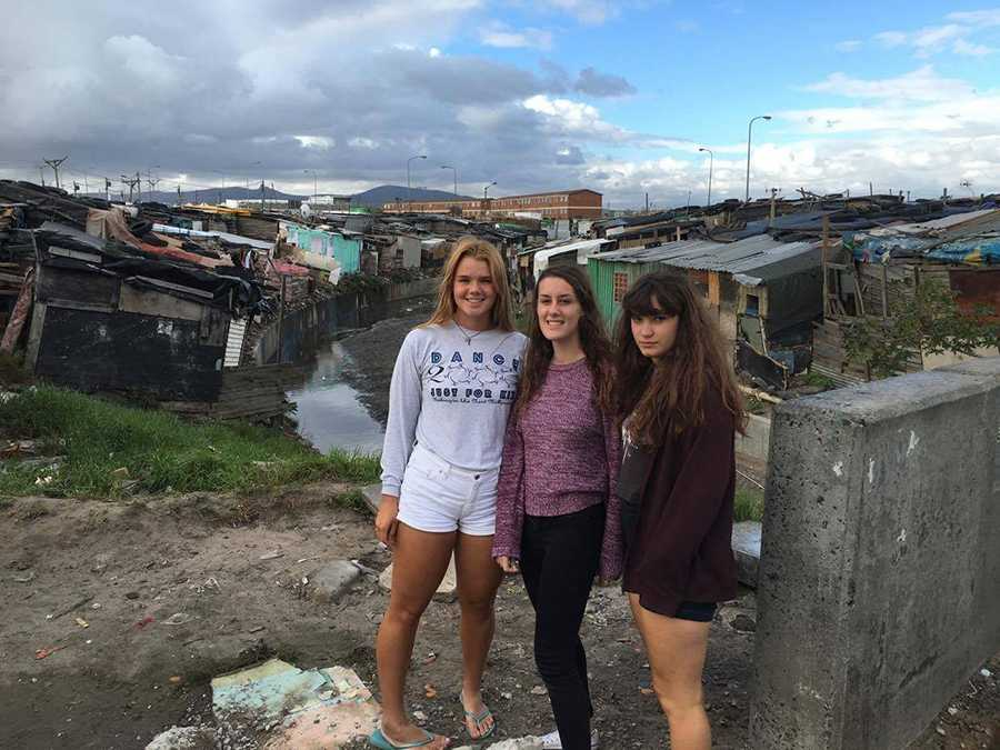 Senior Emily Doss with friends in South Africa. Doss said her travels abroad gave her perspectives as to privilages of United States life in St. Louis Park and the way in which others live elsewhere in the world.