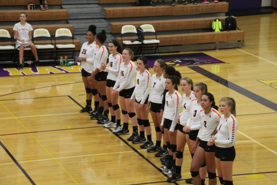 The+girls%E2%80%99+varsity+volleyball+team+lines+up+for+roll+call+for+their+game+against+Chaska+on+September+8th.%0A