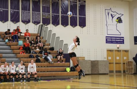 Junior captain Ella Trotter jumps up for the serve.