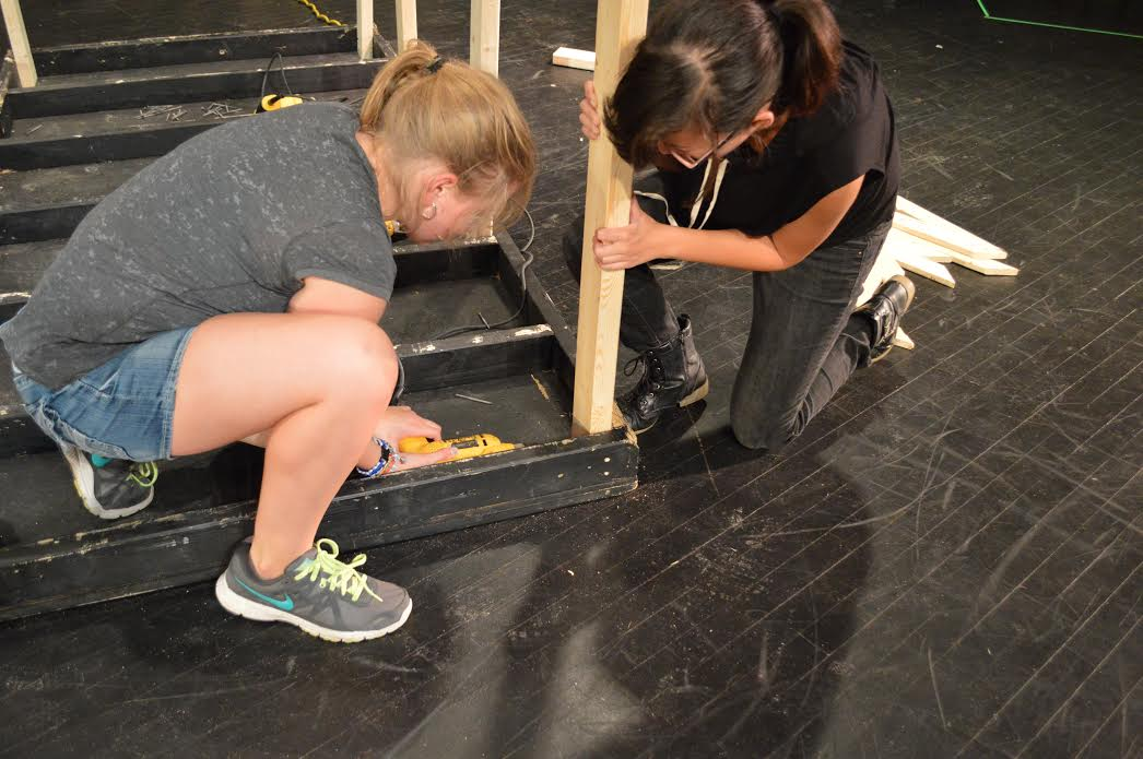 Sophomores Samanthana Schug and Zoey Zachek work on the platform for the fall musical set on Friday, Sept. 23. Theater students are in the process of preparing for their Nov. preformance of