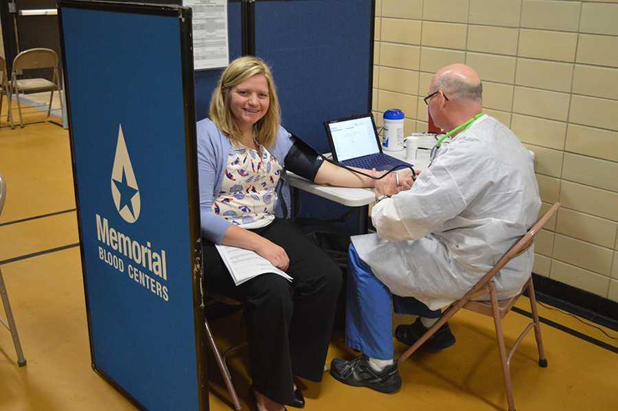Student council adviser Sarah Lindenberg gives blood in the old gym on Sept. 28.