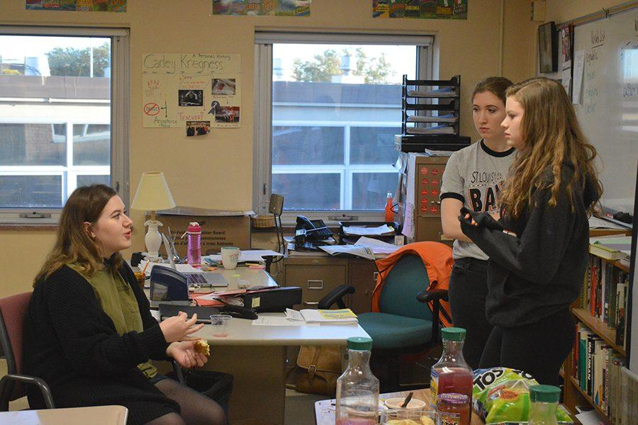 Seniors+Kirby+Goodman%2C+Chloe+O%27Gara+and+Sydney+Hall+discuss+potential+topics+for+the+year+at+the+meeting+Oct.+7.+Feminism+club+will+meet+in+room+C377