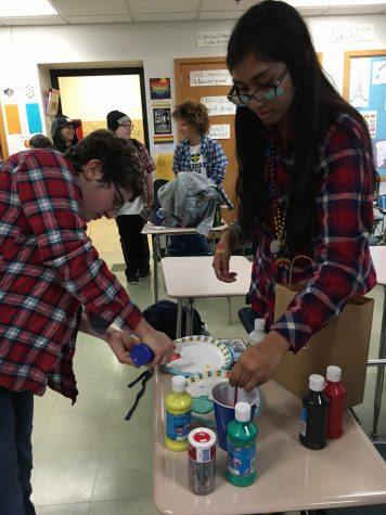 Senior GSA members Tehya Latchman and Elise Bargman celebrated National Coming Out Day Oct. 11 with face paint, glitter and a flannel dress code. T