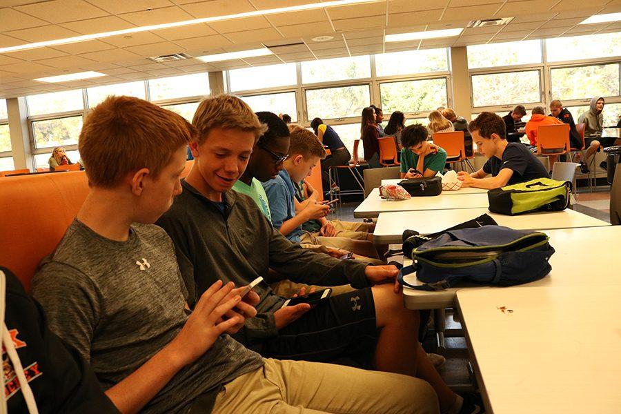 Freshmen+Jamie+Sorenson%2C+Jackson+Aune%2C+Bryan+Okere+and+Ashton+Williams+use+their+cell+phones+during+lunch.+All+four+students+are+frustrated+that+they+are+not+able+to+access+some+social+media+sites+on+the+school+Wi-Fi.