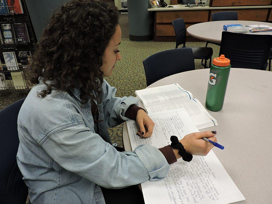 Senior+Danielle+Patterson+focuses+on+her+schoolwork+from+the+classes+she+takes+at+Normandale+Community+College.
