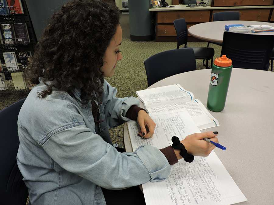 Senior Danielle Patterson focuses on her schoolwork from the classes she takes at Normandale Community College.