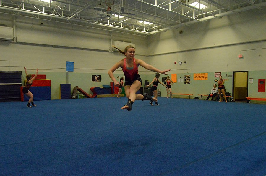 Senior captain Kelsey Knudson practices floor jumps during tryouts. Tryouts took place Nov. 14 through Nov. 18.