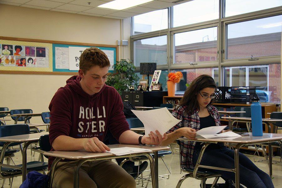 Junior Benjamin Dodge reviews papers at debate club. The club will meet after school Mondays and Thursdays.