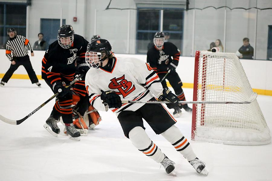 UMN hockey commit  Jonny Sorenson chases the puck as a junior during the boys' hockey game Dec. 6, 2016. against Osseo. Sorenson is currently playing hockey fro the Icedogs in Alaska and has committed to play hockey for the University of Minnesota.